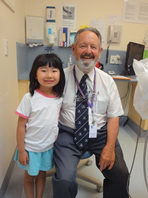 Cassie with Dr John Brownbill, one of Plenty Valley Community Health Centre's dentists.
