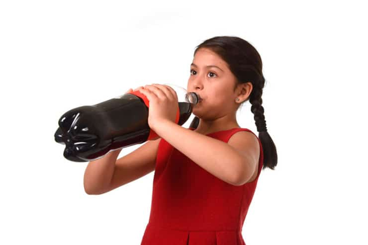 Child drinking big bottle of cola