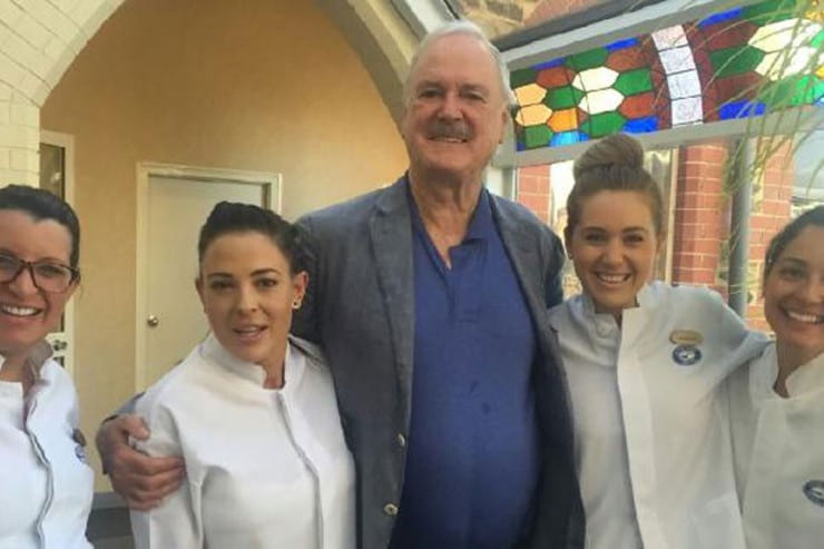 John Cleese poses for photos with staff from Hyde Park Dental after a dental procedure to fix his molar.