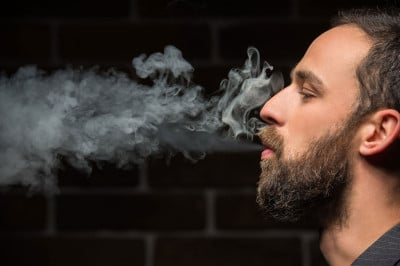 Man blowing smoke from his mouth